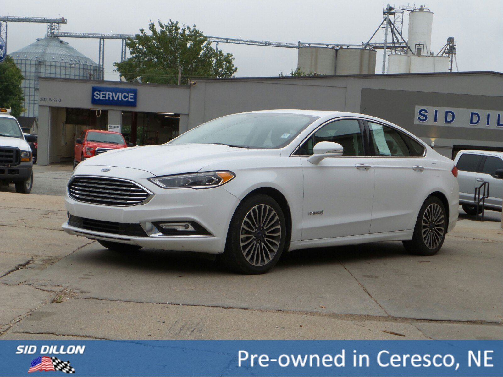 Pre owned 2017 ford fusion hybrid titanium
